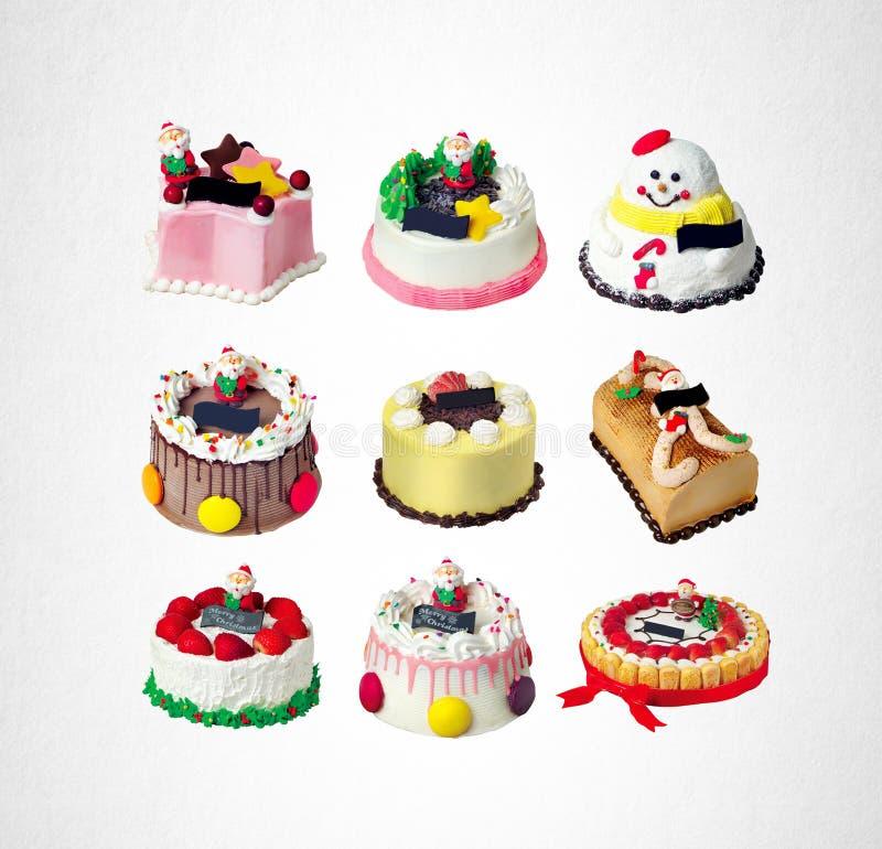 o bolo ou o Natal endurecem a coleção em um fundo foto de stock royalty free