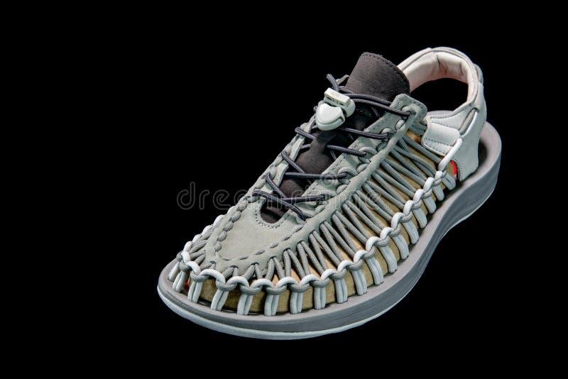 O ` bonito s dos homens e o ` s das mulheres formam a sandália ou as sapatas no CCB preto imagem de stock royalty free