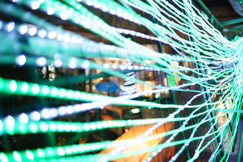 O borrão do foco conduziu a iluminação linear na cerca In o ano novo imagens de stock royalty free
