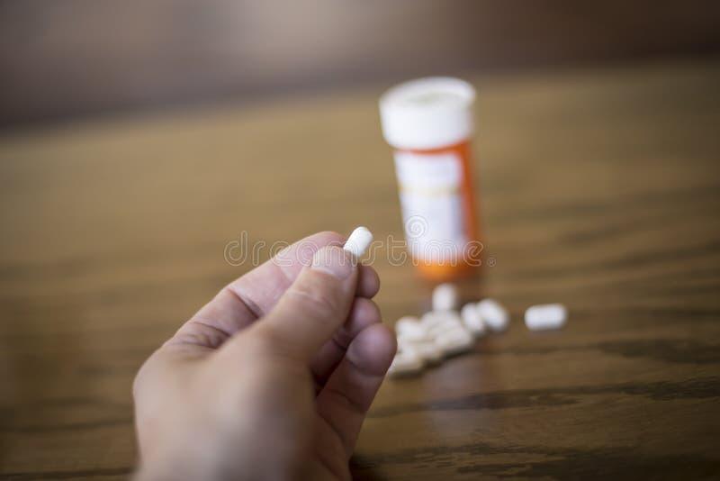 O Brać środek przeciwbólowego obrazy stock