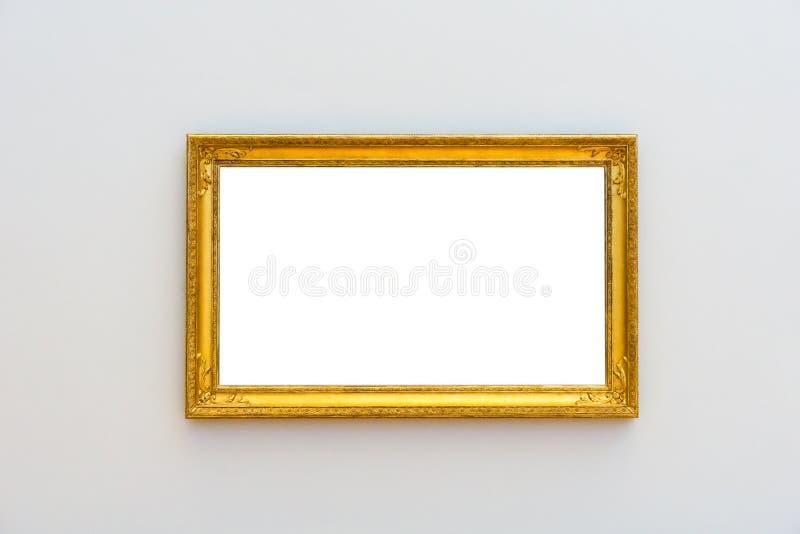 O branco grampeou a pintura com um quadro cinzelado de madeira dourado fotos de stock