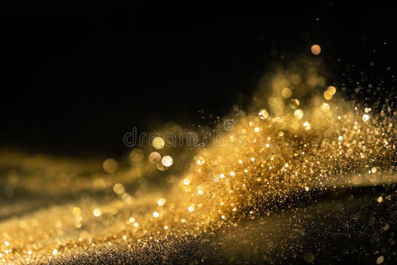 O brilho ilumina o fundo do grunge, fundo Twinkly abstrato defocused das luzes do brilho do ouro imagens de stock royalty free