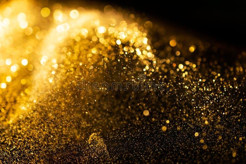 O brilho ilumina o fundo do grunge, fundo Twinkly abstrato defocused das luzes do brilho do ouro foto de stock royalty free