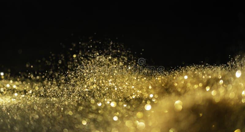 O brilho ilumina o fundo do grunge, fundo Twinkly abstrato defocused das luzes do brilho do ouro fotografia de stock
