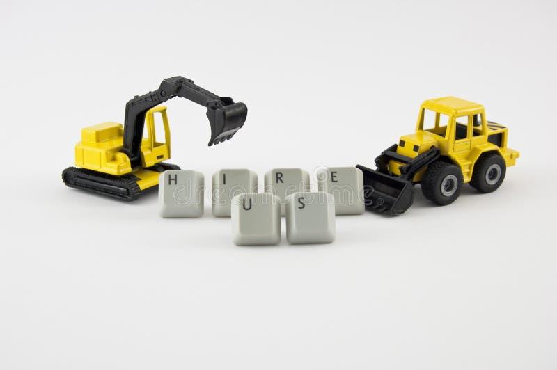 O brinquedo da máquina escavadora e da escavadora com palavras contrata-nos fotos de stock royalty free
