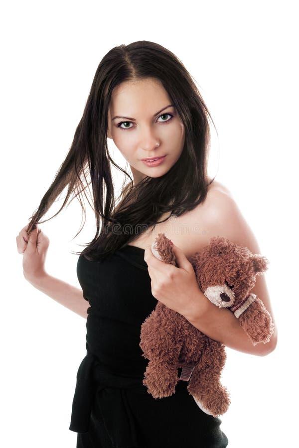 O brunette 'sexy' com peluche-carrega fotos de stock