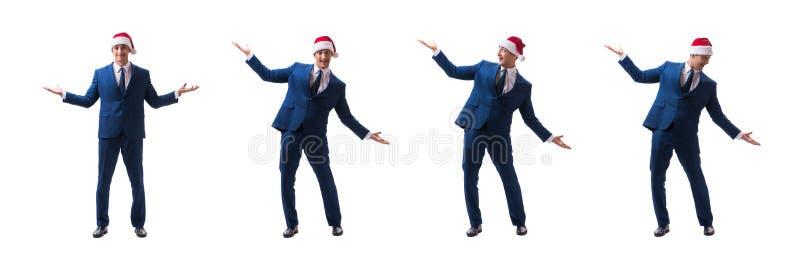 O busnessman novo que veste o chapéu de Santa no conceito do Natal no branco imagem de stock royalty free