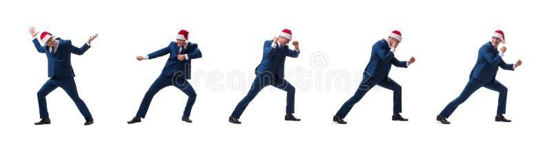 O busnessman novo que veste o chapéu de Santa no conceito do Natal no branco fotos de stock royalty free