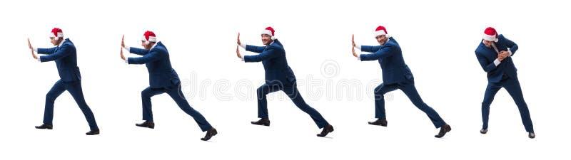 O busnessman novo que veste o chapéu de Santa no conceito do Natal no branco imagens de stock