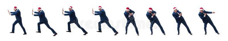 O busnessman novo que veste o chapéu de Santa no conceito do Natal no branco imagens de stock royalty free