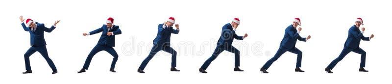 O busnessman novo que veste o chapéu de Santa no conceito do Natal no branco foto de stock royalty free
