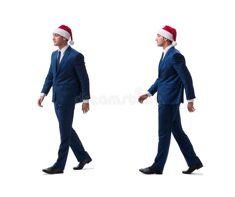 O busnessman novo que veste o chapéu de Santa no conceito do Natal no branco imagem de stock