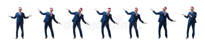 O busnessman novo que veste o chap?u de Santa no conceito do Natal no branco fotos de stock