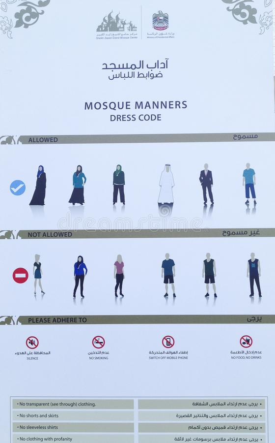 O código de vestimenta assina dentro Sheikh Zayed Grand Mosque foto de stock