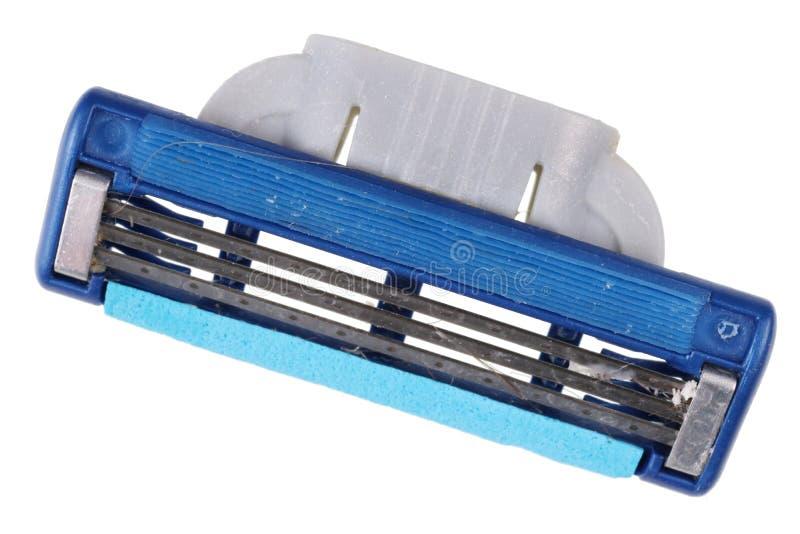O cabelo e as partes faciais da pele são colados em uma lâmina de lâmina suja fotografia de stock