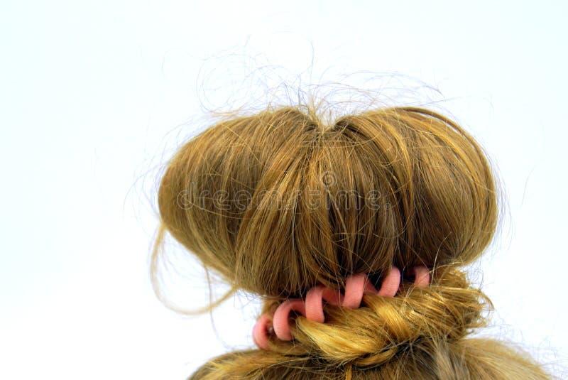 O cabelo louro arranjou em um nó fotografia de stock royalty free