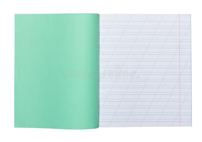 O caderno aberto da escola em uma linha estreita com um corte para aprender a soletração, zomba acima com o espaço da cópia isola imagens de stock