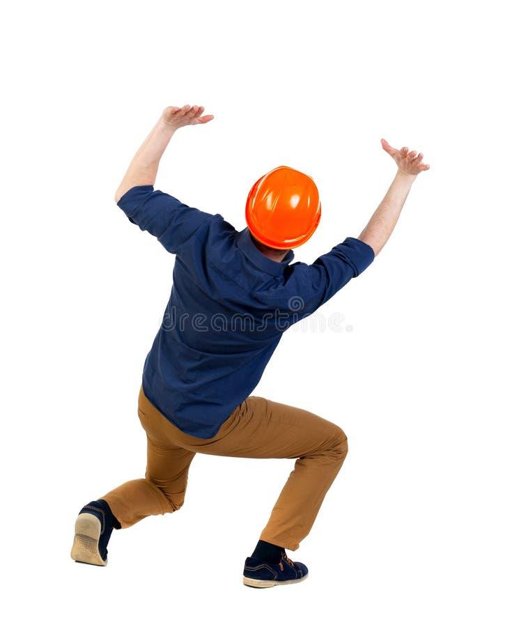 O capacete protetor traseiro da construção do homem de negócio da vista protege h foto de stock royalty free