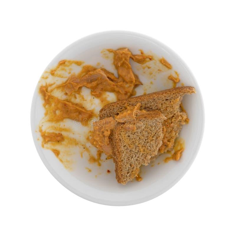 O caril comido flavored o sanduíche dos peixes de atum em uma bacia fotos de stock royalty free