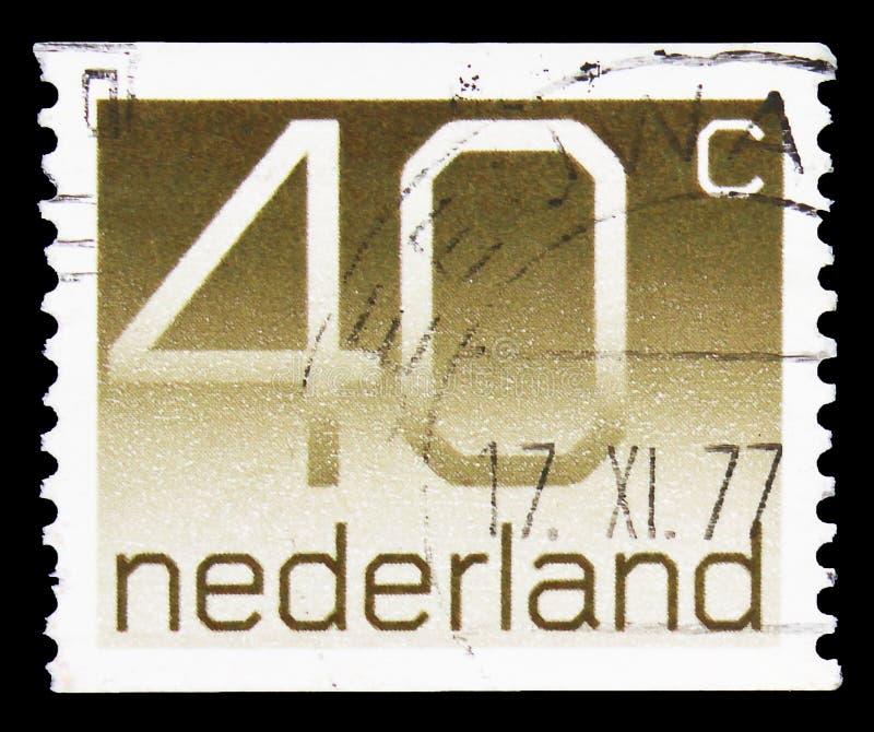O carimbo postal impresso nos Países Baixos apresenta a série Numeral, Figura 'Crouwel', cerca de 1976 imagens de stock royalty free