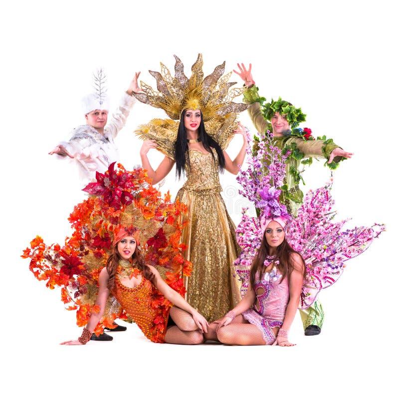 O carnaval vestindo da equipe do dançarino traja a dança foto de stock royalty free