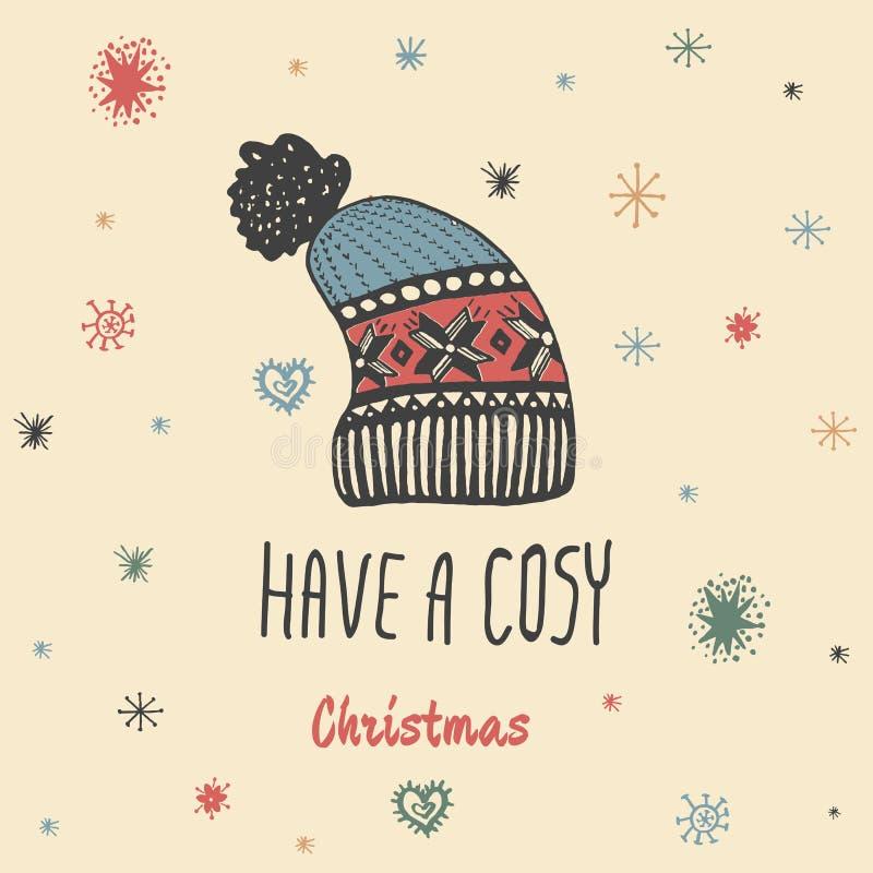 O cartão do vintage do Natal com com o chapéu feito malha tirado mão do inverno e o texto 'têm um Natal confortável' ilustração royalty free