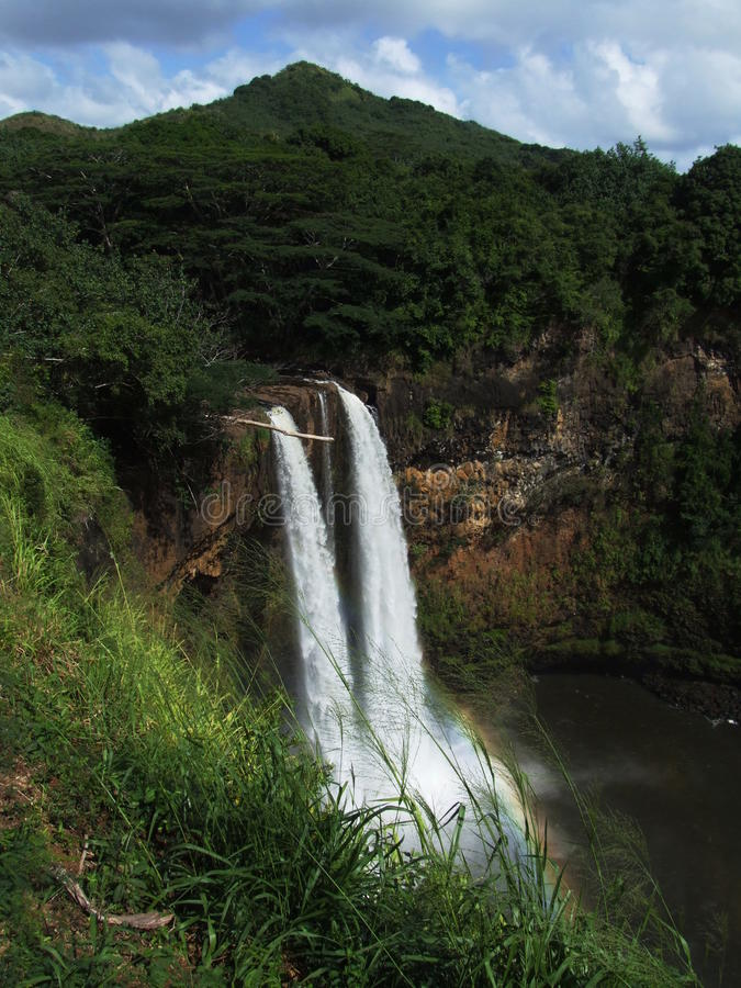 O cerco bonito de Wailua cai, Kauai, Havaí fotografia de stock royalty free