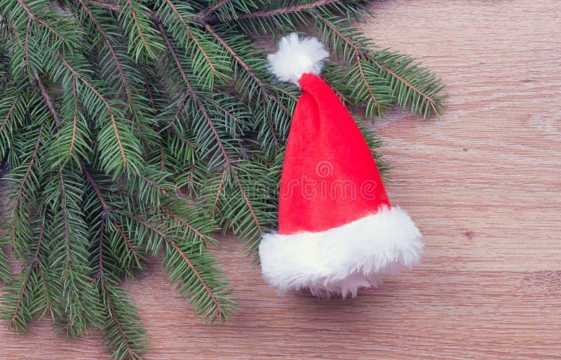 Download O chapéu de Santa foto de stock. Imagem de filial, christmas - 29828938