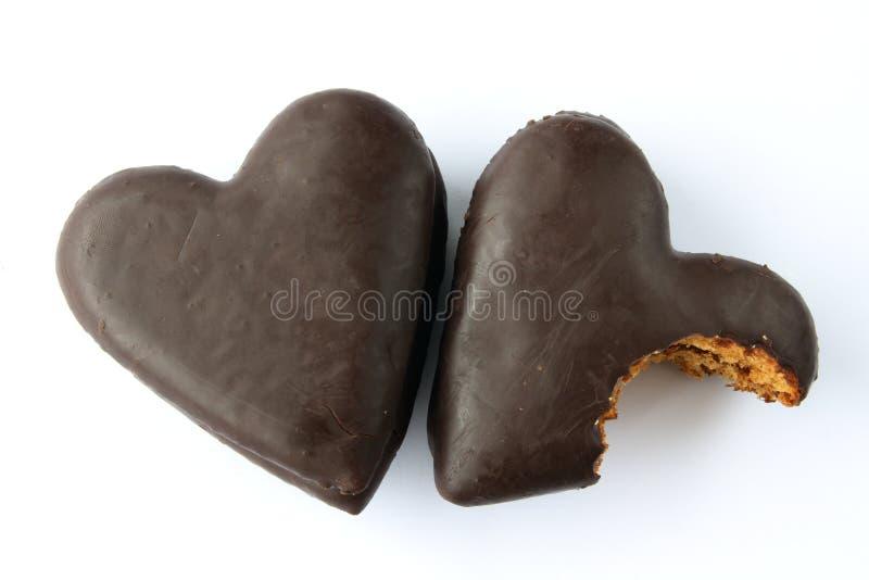 O chocolate cobriu corações do pão-de-espécie fotografia de stock royalty free