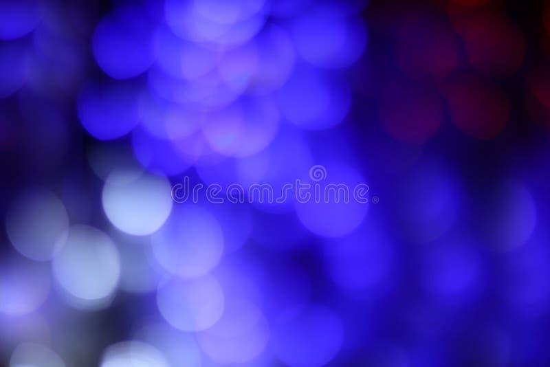 O ciclo abstrato azul do bokeh que ilumina o fundo colorido vívido, bokeh azul do brilho borrou o fundo imagens de stock