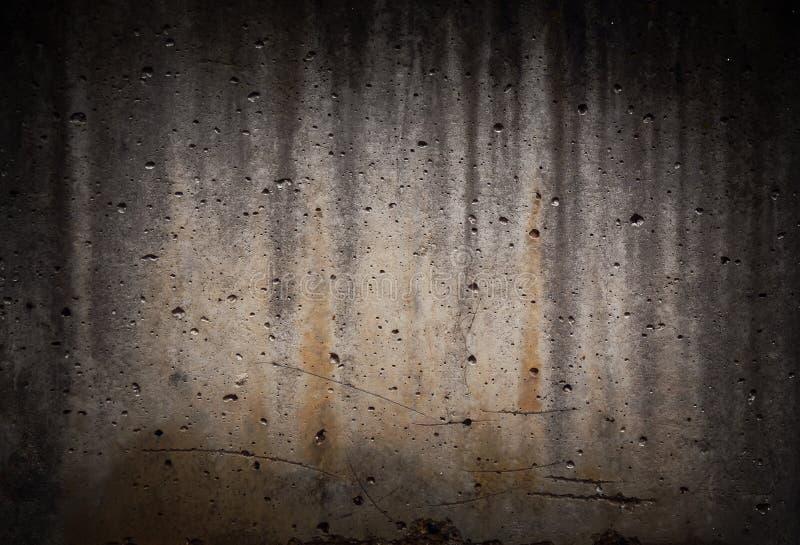 O cimento de pedra sujo concreto do vignetting preto velho rachou a parede foto de stock royalty free