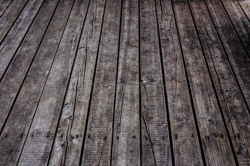 O cinza envelhecido nonpainted o fundo de madeira de superfície da textura da perspectiva das pranchas do assoalho imagens de stock royalty free