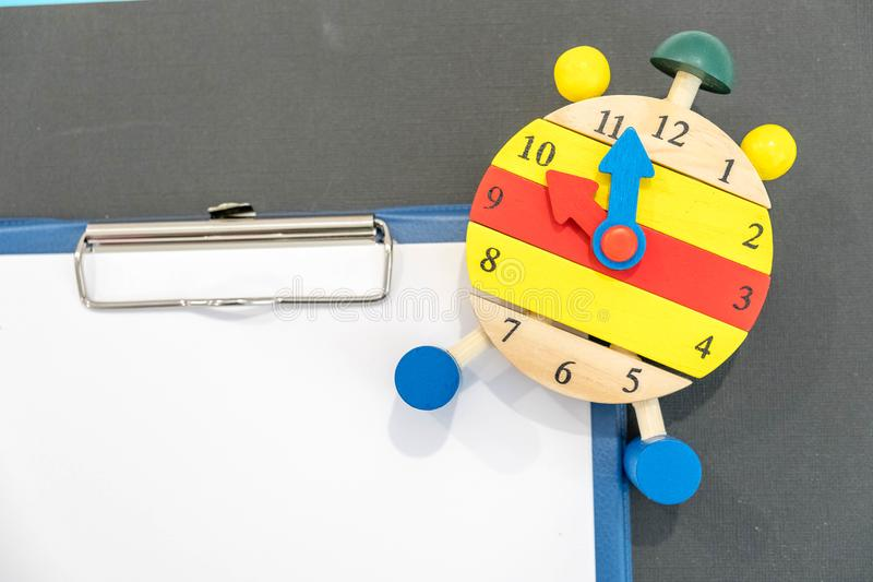 12 o`clock. Time management concept. Close-up Of Alarm Clock. back to school. Banner for Change your clocks message. Creative desk stock photo