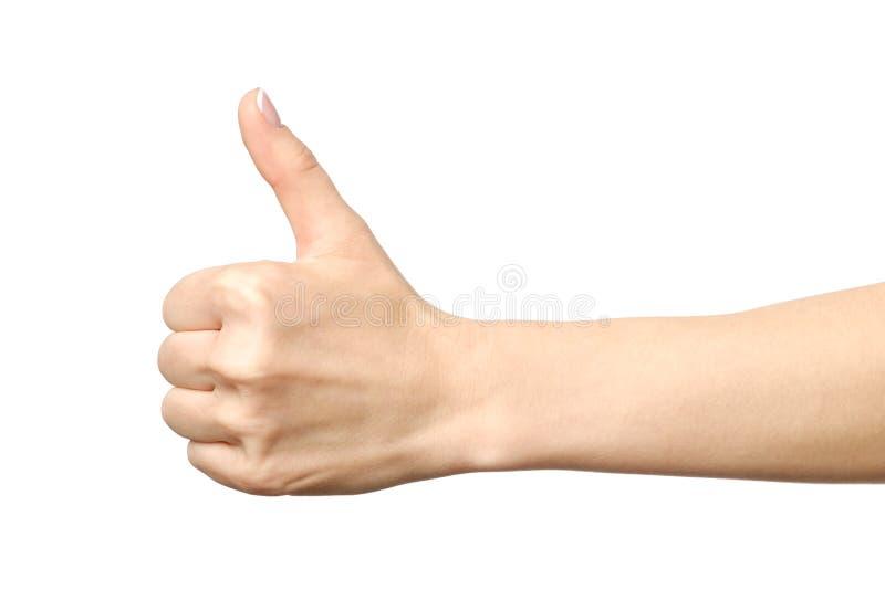 O close up da mão fêmea que mostra os polegares levanta o sinal imagens de stock royalty free