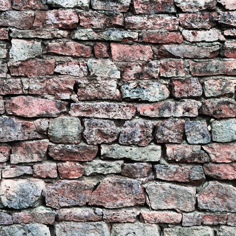 O close up da parede de pedra, obstrói o fundo do teste padrão, a ardósia dura resistida envelhecida velha do cálcio vermelho e c fotografia de stock royalty free