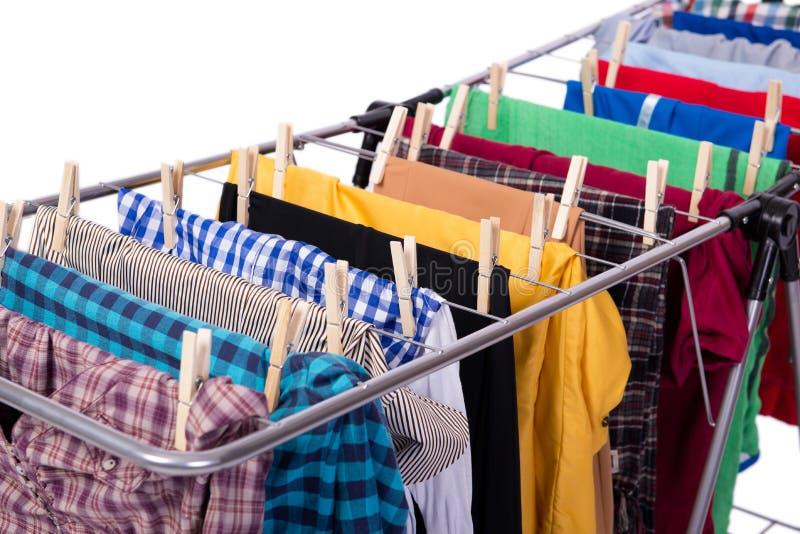 O clotheshorse dobrável isolado no fundo branco foto de stock