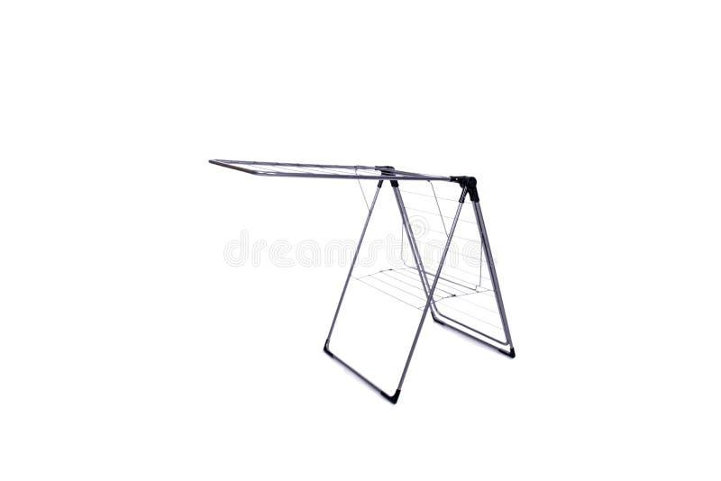 O clotheshorse dobrável isolado no fundo branco fotografia de stock