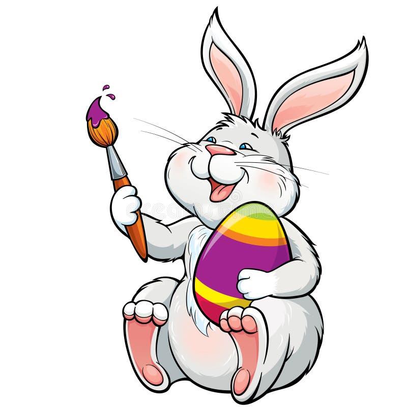 O coelho feliz bonito com escova pinta o ovo da páscoa ilustração stock