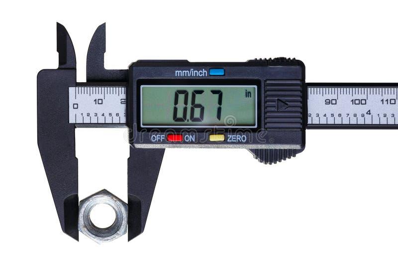 O compasso de calibre digital a porca velha fotografia de stock royalty free