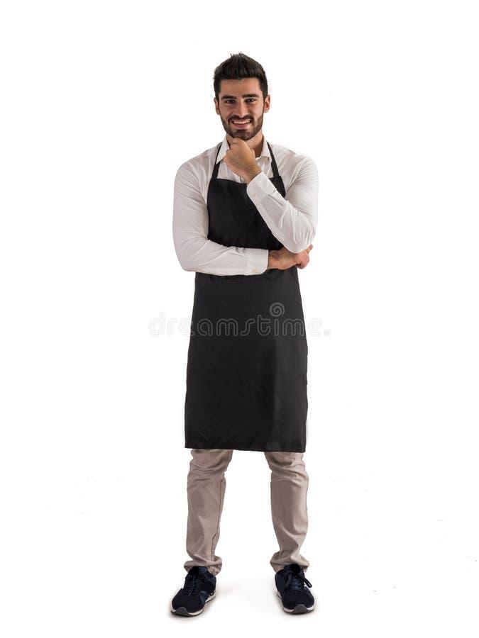 O comprimento completo disparou do levantamento novo do cozinheiro chefe ou do gar?om imagens de stock royalty free