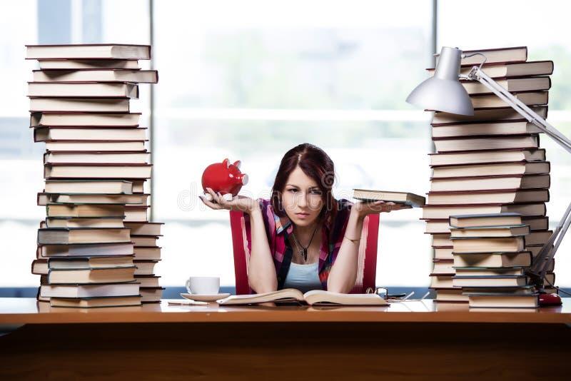 O conceito de livros de texto caros com estudante fêmea fotografia de stock royalty free