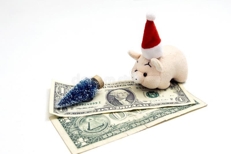 O conceito do custo do Natal em América, ou quanto custa para comemorar o ano novo do porco O rosa do brinquedo leitão dentro imagem de stock royalty free