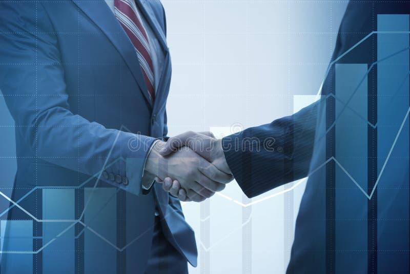 O conceito do negócio da cooperação com o aperto de mão fotografia de stock