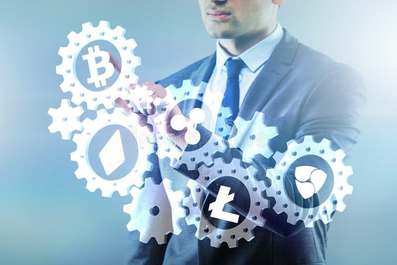 O conceito dos cryptocurrencies com o homem que pressiona botões fotografia de stock royalty free