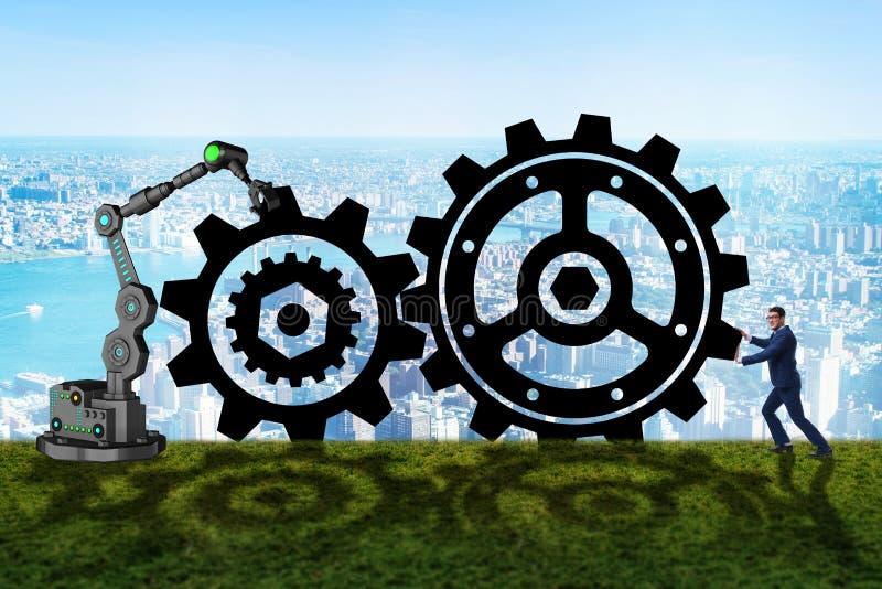 O conceito dos trabalhos de equipa com homem de negócios e rodas denteadas imagens de stock