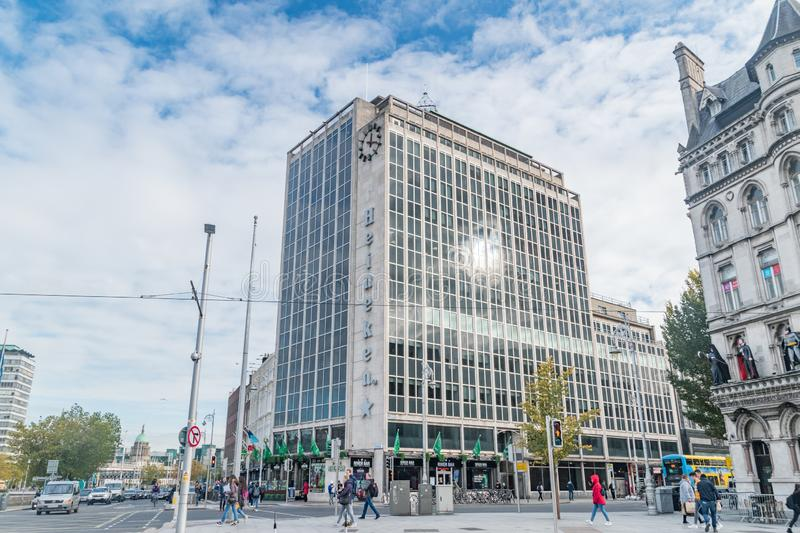 O`Connell Bridge House, or the Heineken Building Nicknamed the Heineken Building because of the advert on the side. Dublin, Ireland - November 6, 2019: O`Connell royalty free stock photography