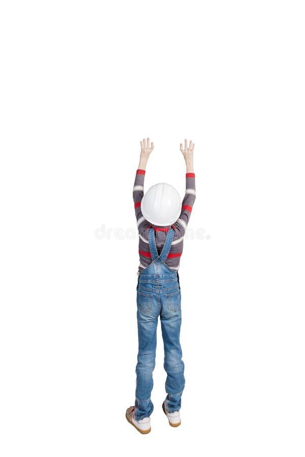 O construtor do menino está com o seu para trás, isolado fotografia de stock