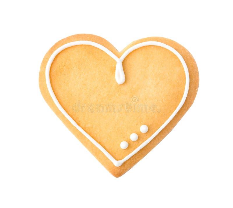 O coração decorado deu forma à cookie no fundo branco imagens de stock