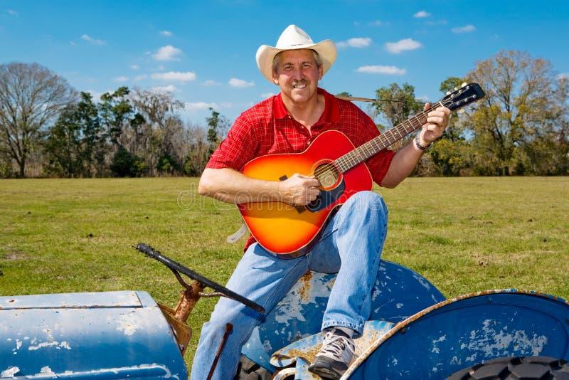 O cowboy de canto Strums a guitarra fotos de stock
