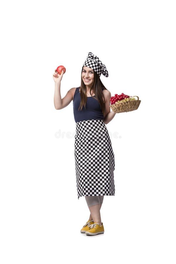 O cozinheiro da jovem mulher isolado no fundo branco foto de stock